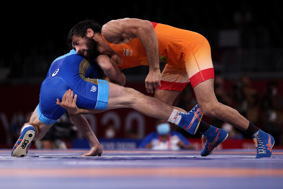 CHIBA, JAPAN - AUGUST 05: Zavur Uguev of Team ROC competes against Kumar Ravi of Team India during the Men's Freestyle 57kg Final on day thirteen of the Tokyo 2020 Olympic Games at Makuhari Messe Hall on August 05, 2021 in Chiba, Japan. (Photo by Maddie Meyer/Getty Images)