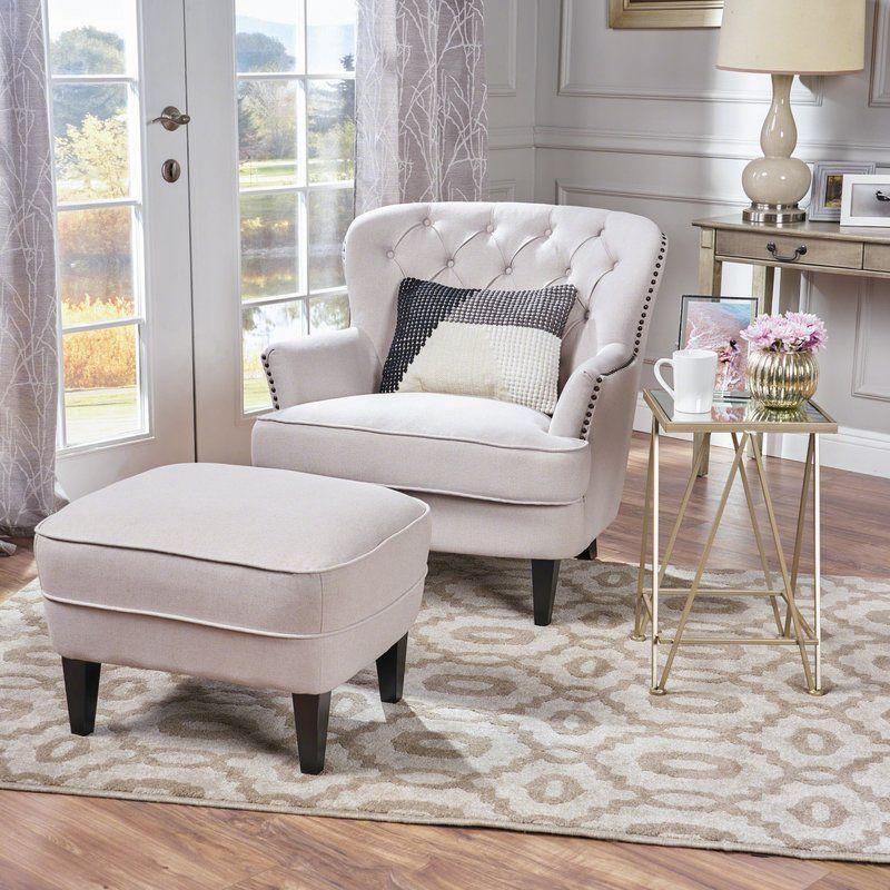 """<p><strong>Willa Arlo Interiors</strong></p><p>wayfair.com</p><p><a href=""""https://go.redirectingat.com?id=74968X1596630&url=https%3A%2F%2Fwww.wayfair.com%2Ffurniture%2Fpdp%2Fwilla-arlo-interiors-heywood-armchair-wrlo1179.html&sref=https%3A%2F%2Fwww.countryliving.com%2Fhome-design%2Fg31785674%2Ftop-cozy-chairs%2F"""" rel=""""nofollow noopener"""" target=""""_blank"""" data-ylk=""""slk:CHECK PRICE"""" class=""""link rapid-noclick-resp"""">CHECK PRICE</a></p><p>This roomy chair has enough space for you to curl up with a good book. It's also tufted for a positively regal look.</p>"""