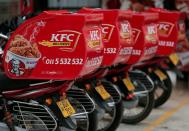 FILE PHOTO: Delivery boxes on motorcycles are seen at a KFC fast food outlet, amid concerns about the spread of the coronavirus disease (COVID-19), in Colombo