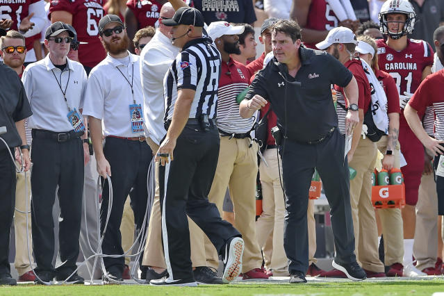 South Carolina head coach Will Muschamp has a word with an official during the first half of an NCAA college football game against Alabama Saturday, Sept. 14, 2019, in Columbia, S.C. (AP Photo/Richard Shiro)
