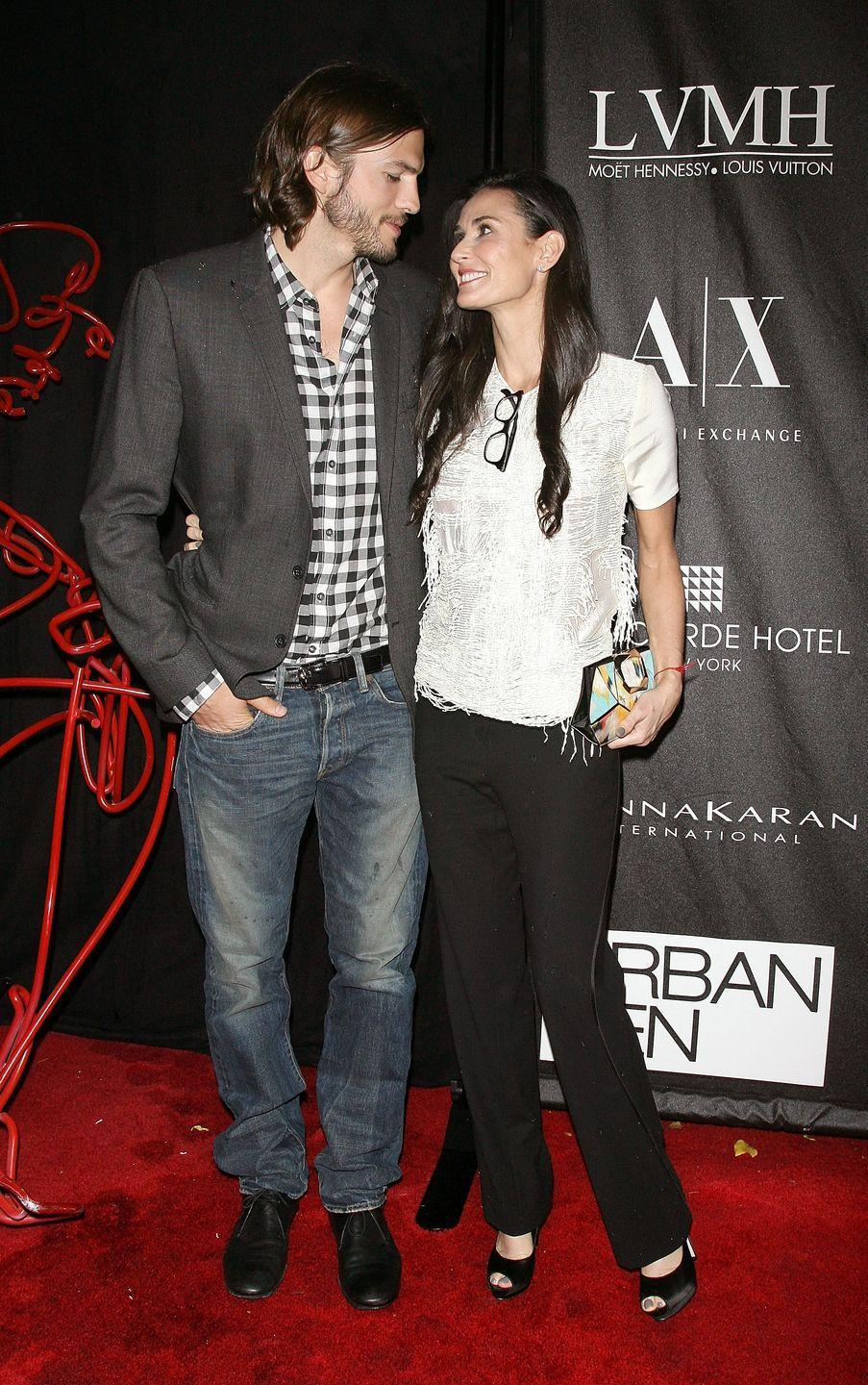 """<p>Despite their 16-year age difference, Kutcher married Moore in 2005. When they split in 2011, she released a statement to <em><a href=""""https://www.eonline.com/photos/3833/demi-moore-ashton-kutcher-romance-recap/144816"""" rel=""""nofollow noopener"""" target=""""_blank"""" data-ylk=""""slk:E! News"""" class=""""link rapid-noclick-resp"""">E! News</a> </em>that said: """"It is with great sadness and a heavy heart that I have decided to end my six-year marriage to Ashton."""" </p>"""