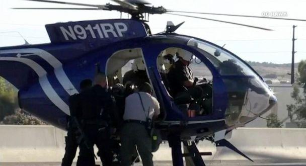 PHOTO: A police helicopter airlifted the injured CHP officer to the hospital. (OC Hawk)