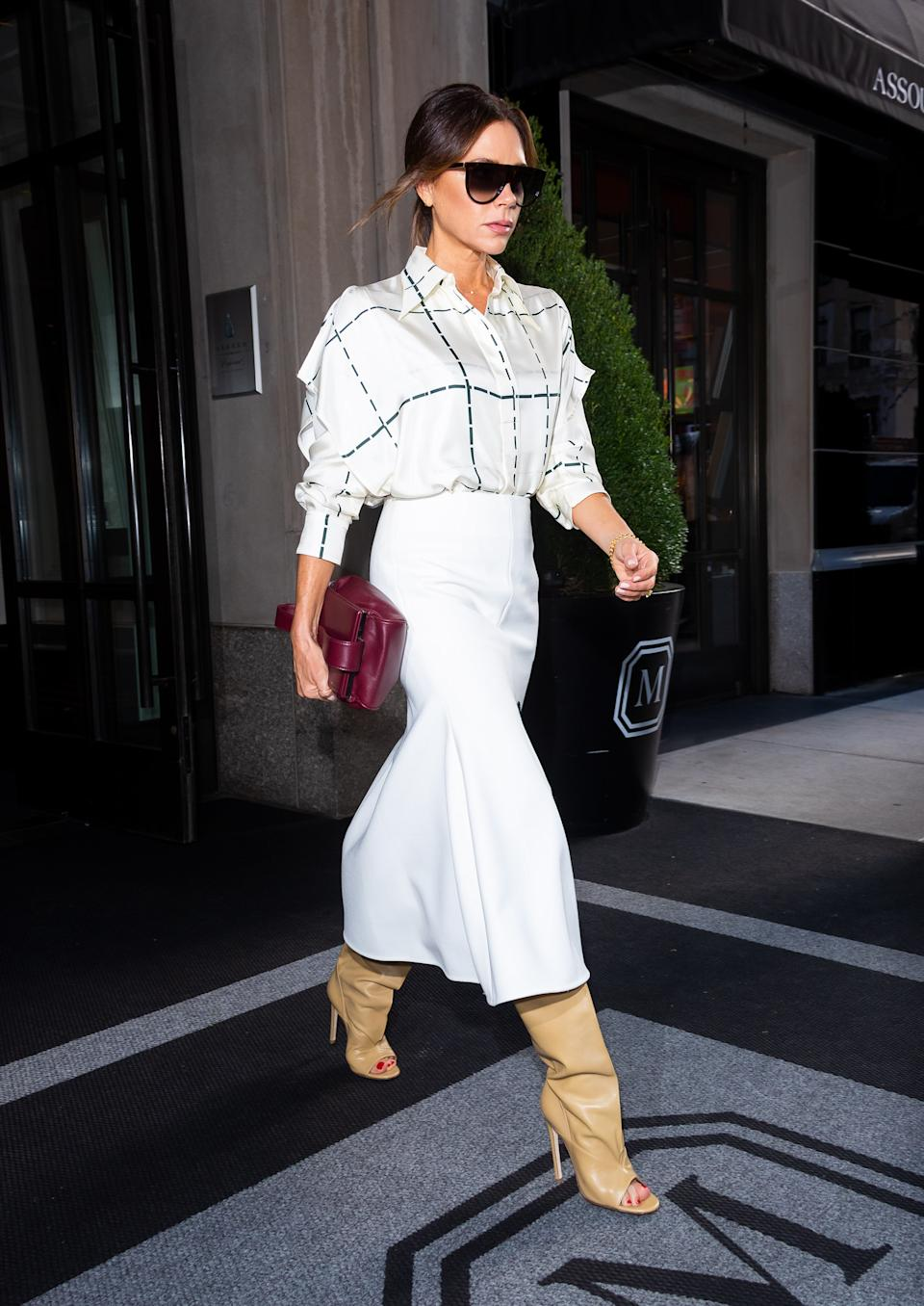 Victoria Beckham wearing slouch boots from her own collection. [Photo: Getty]
