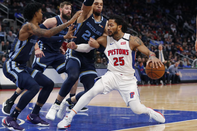 Detroit Pistons guard Derrick Rose (25) runs into the defense of Memphis Grizzlies guard Ja Morant (12), center Jonas Valanciunas (17) and guard Dillon Brooks (24) during the second half of an NBA basketball game, Friday, Jan. 24, 2020, in Detroit. (AP Photo/Carlos Osorio)