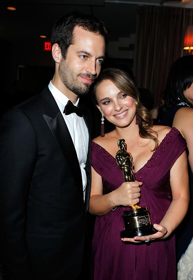 """Natalie Portman (in a plum, off-the-shoulder Rodarte gown and Tiffany tassel earrings) held her Best Actress Oscar tight while resting against her baby daddy/""""Black Swan"""" choreographer, Benjamin Millepied, at Sunset Tower."""
