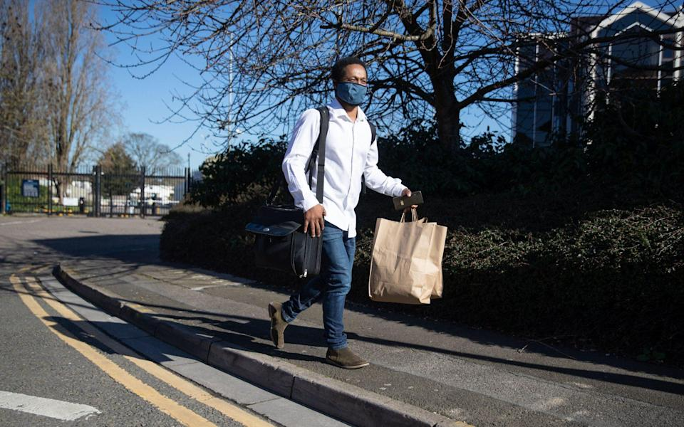 Theo Paulse, 39, leaves the Radisson Blu Edwardian hotel, near Heathrow Airport, London, after he completed his 10-day stay at the Government-designated quarantine hotel - Andrew Matthews/PA