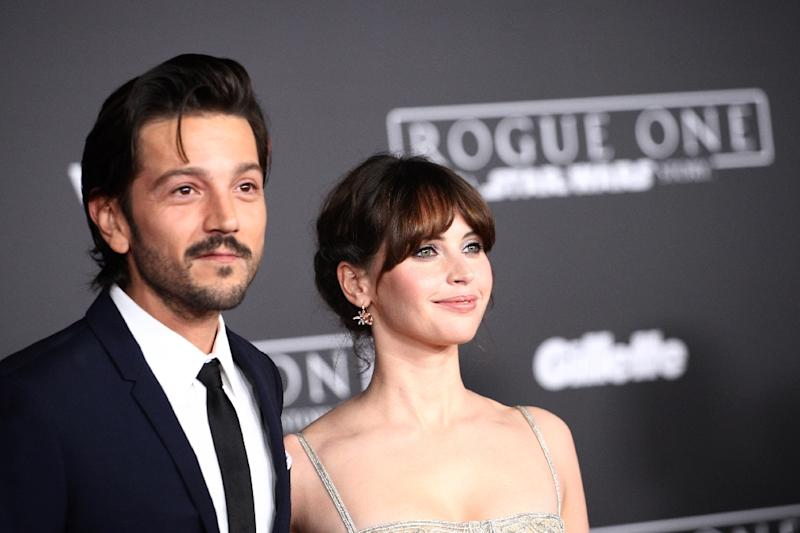 """Diego Luna and Felicity Jones attend The World Premiere of Lucasfilm's """"Rogue One: A Star Wars Story, In Hollywood, California, on December 10, 2016"""