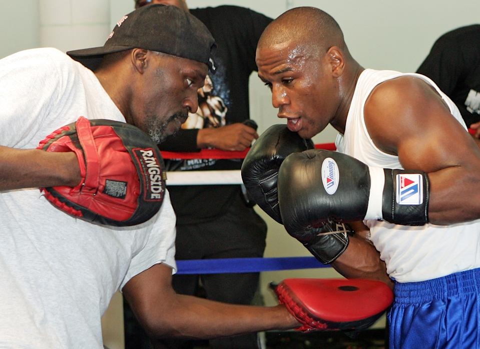 Boxer Floyd Mayweather Jr. (R) works out with his trainer and uncle Roger Mayweather at the Mayweather Boxing Club May 1, 2007 in Las Vegas, Nevada. Mayweather Jr. will fight Oscar De La Hoya for the WBC super welterweight championship at the MGM Grand on May 5, 2007.  (Photo by Ethan Miller/Getty Images)
