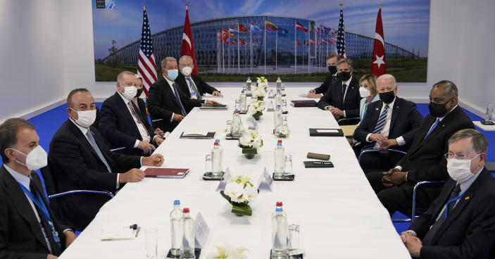 President Joe Biden, center right, and Turkish President Recep Tayyip Erdogan, center left, visit during a bilateral meeting while attending the NATO summit at NATO headquarters in Brussels, Monday, June 14, 2021. (AP Photo/Patrick Semansky)