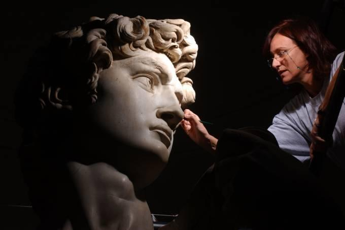 Accademia Gallery worker carefully works to restore Michelangelo's