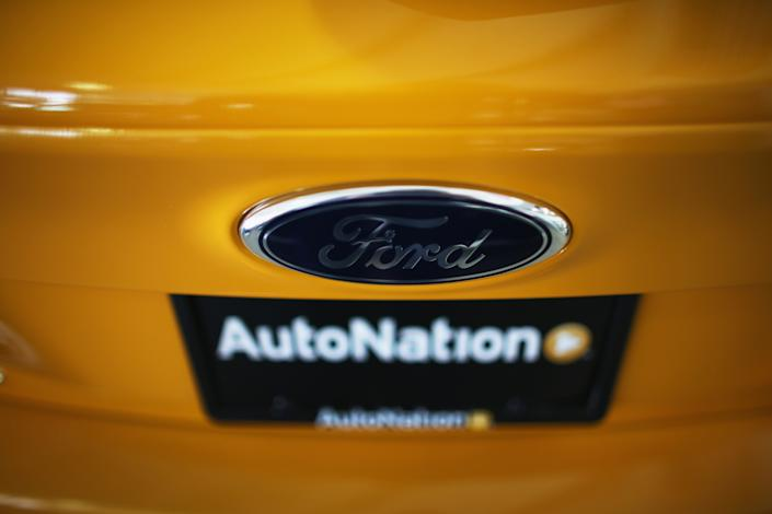 NORTH MIAMI, FL - SEPTEMBER 04:  A Ford emblem is seen on the hood of a car at a Ford AutoNation car dealership on September 4, 2013 in North Miami, Florida. Ford announced it sold 221,270 vehicles in August, a 12.2% increase from the prior year, which makes it the best retail month for Ford Motor Co. going back to August 2006.  (Photo by Joe Raedle/Getty Images)