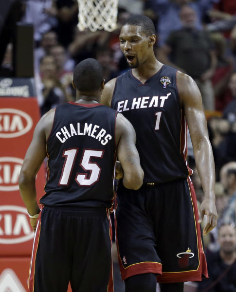 Miami Heat's Chris Bosh (1) congratulates teammate Mario Chalmers (15) after Chalmers scored a three-pointer against the Indiana Pacers during the second half of an NBA basketball game in Miami, Sunday, March 10, 2013. The Heat won 105-91. (AP Photo/Alan Diaz)