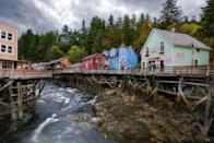 """<p>The town of Ketchikan, Alaska, has charming shopping historic buildings on stilts, but these bright colored buildings use to be the <a href=""""https://www.alaska.org/detail/dollys-house-museum"""" rel=""""nofollow noopener"""" target=""""_blank"""" data-ylk=""""slk:town's red-light district"""" class=""""link rapid-noclick-resp"""">town's red-light district</a>. </p>"""