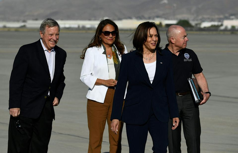 Vice President Kamala Harris is welcomed by Homeland Security Secretary Alejandro Mayorkas, right, Sen. Dick Durbin, D-Ill., left, and Rep. Veronica Escobar, D-Texas, second from left, upon arrival at El Paso International Airport, on June 25, 2021, in El Paso, Texas.