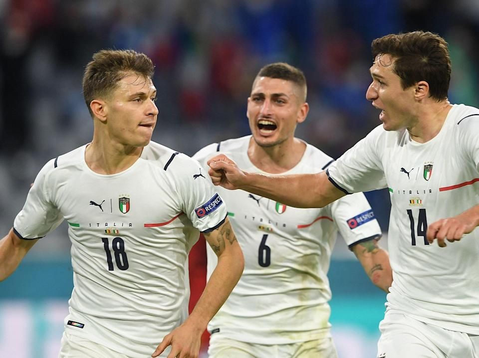 Nicolo Barella (left) celebrates with Italy team-mates after scoring (POOL/AFP via Getty Images)