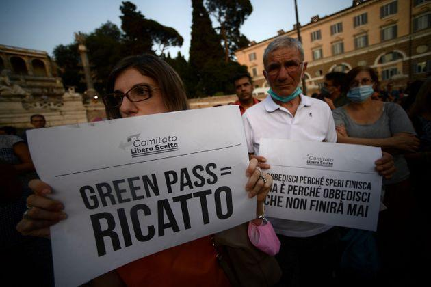 Protestors take part in a demonstration against the introduction of a mandatory 'green pass', in Piazza del Popolo in Rome, on July 28, 2021. - Italy on July 22 said a health pass would be mandatory for people wishing to access bars, restaurants, swimming pools, sports facilities, museums and theatres from August 6. (Photo by Filippo MONTEFORTE / AFP) (Photo by FILIPPO MONTEFORTE/AFP via Getty Images) (Photo: FILIPPO MONTEFORTE via Getty Images)