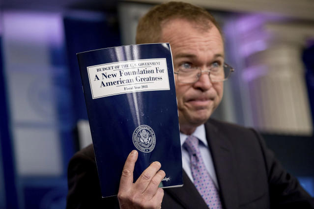 <p>Budget Director Mick Mulvaney holds up a copy of President Donald Trump's proposed fiscal 2018 federal budget as he speaks to members of the media in the Press Briefing Room of the White House in Washington, May 23, 2017. (Photo: Andrew Harnik/AP) </p>