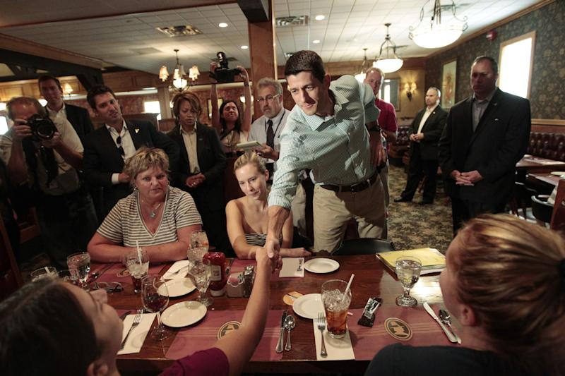 FILE - In this Aug. 25, 2012, file photo, Republican vice presidential candidate, Rep. Paul Ryan, R-Wis., speaks to diners at Puritan Backroom restaurant in Manchester, N.H. Ryan is sorry you couldn't get into his event here. He feels badly you had to wait for him to arrive at the county fairgrounds in Virginia. He wants to meet you but he promises he won't disrupt business by staying too long at your New Hampshire restaurant. Oh, and please, he says, take a seat. Ryan, a Wisconsin congressman and Mitt Romney's vice presidential pick, is a model of unassuming, Midwestern courtesy. That quality likely will be on display later this week when Ryan debates Vice President Joe Biden. (AP Photo/Mary Altaffer, File)