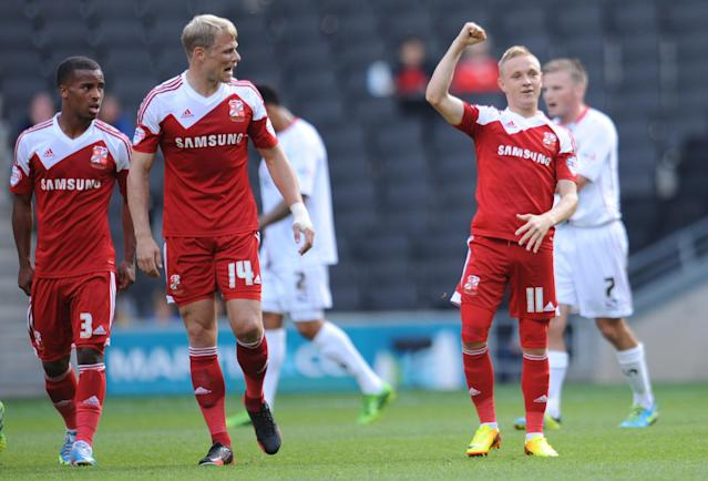 Swindon Town's Alex Pritchard celebrates scoring during the Sky Bet Football League One match at Stadium:MK, Milton Keynes.