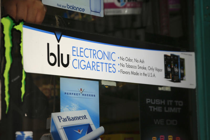 An advertisement for the e-cigarette brand blu is seen on the window of a store in New York May 27, 2014. Some of the leading U.S. producers of electronic cigarettes are moving their manufacturing to the United States from China in response to growing concern about quality and the prospect of tighter federal regulations. Lorillard Inc's blu brand is assembled in China but the liquid is produced in the United States. Reuters reported earlier this week that Reynolds was in active discussions to buy Lorillard. Blu is the top selling e-cigarette brand in the country, with about half of the market share. REUTERS/Shannon Stapleton(UNITED STATES - Tags: SOCIETY BUSINESS)