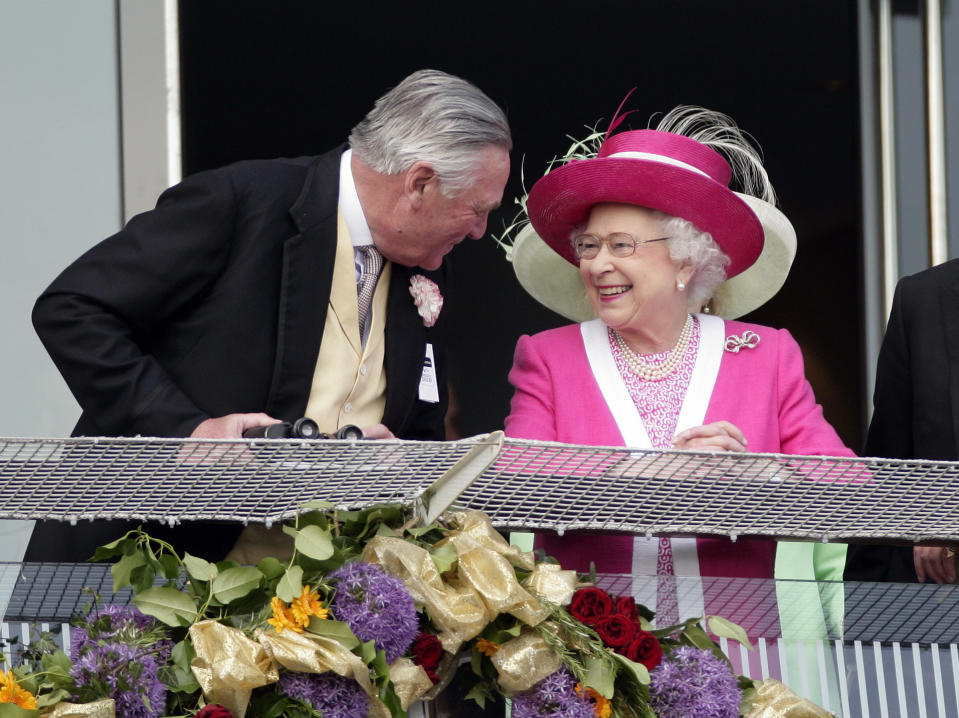 EPSOM, UNITED KINGDOM - JUNE 04: (EMBARGOED FOR PUBLICATION IN UK NEWSPAPERS UNTIL 48 HOURS AFTER CREATE DATE AND TIME) Lord Samuel Vestey, Master of the Horse talks with Queen Elizabeth II on the balcony of the Royal Box as they attend Derby Day at the Investec Derby Festival at Epsom racecourse on June 4, 2011 in Epsom, England. (Photo by Indigo/Getty Images)
