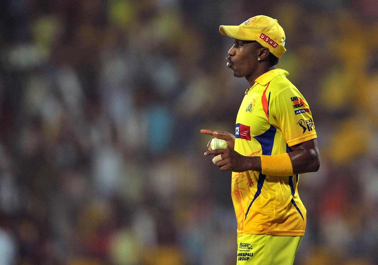 Chennai Super Kings fielder Dwayne Bravo gestures as he celebrates taking a catch to dismiss Delhi Daredevils batsman Andre Russell during the IPL Twenty20 cricket 2nd Qualifier match between Chennai Super Kings and Delhi Daredevils at the M.A. Chidambaram Stadium in Chennai on May 25, 2012. Delhi Daredevils are chasing a target of 223 runs set by Chennai Super Kings. RESTRICTED TO EDITORIAL USE. MOBILE USE WITHIN NEWS PACKAGE. AFP PHOTO/Manjunath KIRAN        (Photo credit should read Manjunath Kiran/AFP/GettyImages)