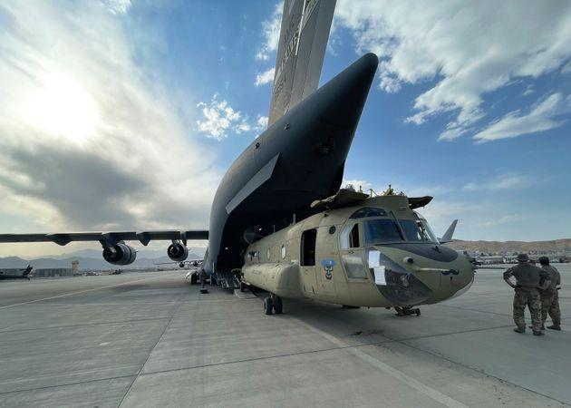 A CH-47 Chinook from the 82nd Combat Aviation Brigade, 82nd Airborne Division is loaded onto a U.S. Air Force C-17 Globemaster III on Saturday at Hamid Karzai International Airport in Kabul (Photo: U.S. Department of Defense via AP)