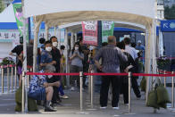 People wait to get coronavirus testing at a testing site in Seoul, South Korea, Wednesday, July 21, 2021.(AP Photo/Ahn Young-joon)