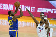 Golden State Warriors forward Andrew Wiggins (22) takes a 3-point shot over Los Angeles Clippers guard Paul George (13) during the second half of an NBA basketball game in San Francisco, Friday, Jan. 8, 2021. The Warriors won 115-105. (AP Photo/Tony Avelar)