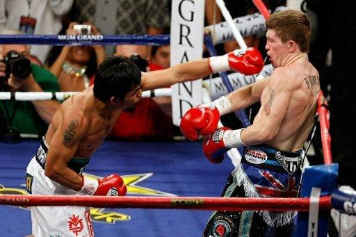 Manny Pacquiao of the Philippines throws a left to the head of Ricky Hatton of England in 2009