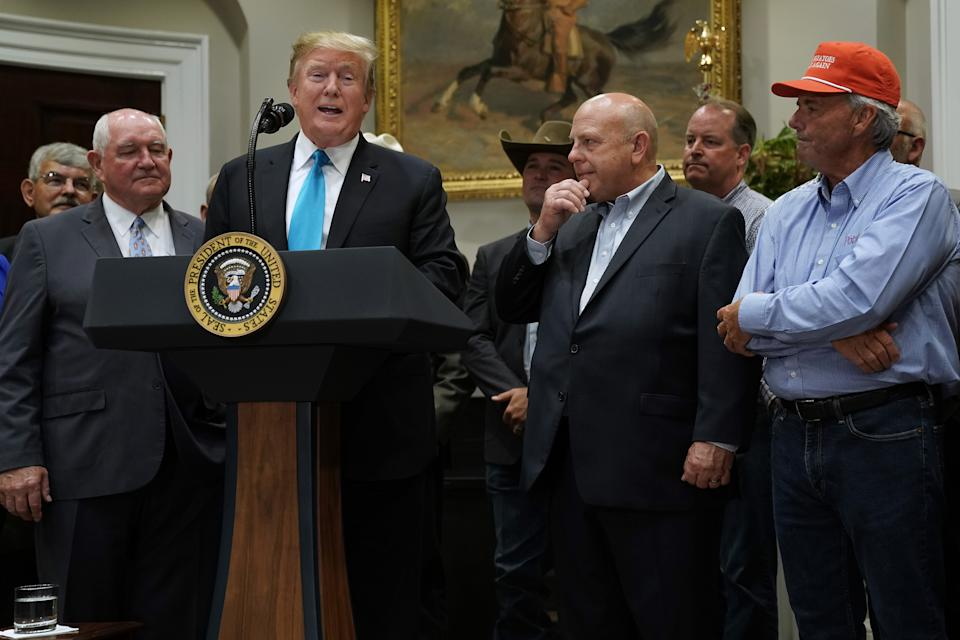 WASHINGTON, DC - MAY 23: U.S. President Donald Trump (C) delivers remarks in support of farmers and ranchers with Agriculture Secretary Sonny Perdue (2nd L) in the Roosevelt Room at the White House May 23, 2019 in Washington, DC. As the U.S.-China trade war continues to hurt American farmers with tariffs on everything from peanut butter to soybeans and orange juice, the federal government announced Thursday it will give an additional $16 billion bailout to those most affected. (Photo by Chip Somodevilla/Getty Images)