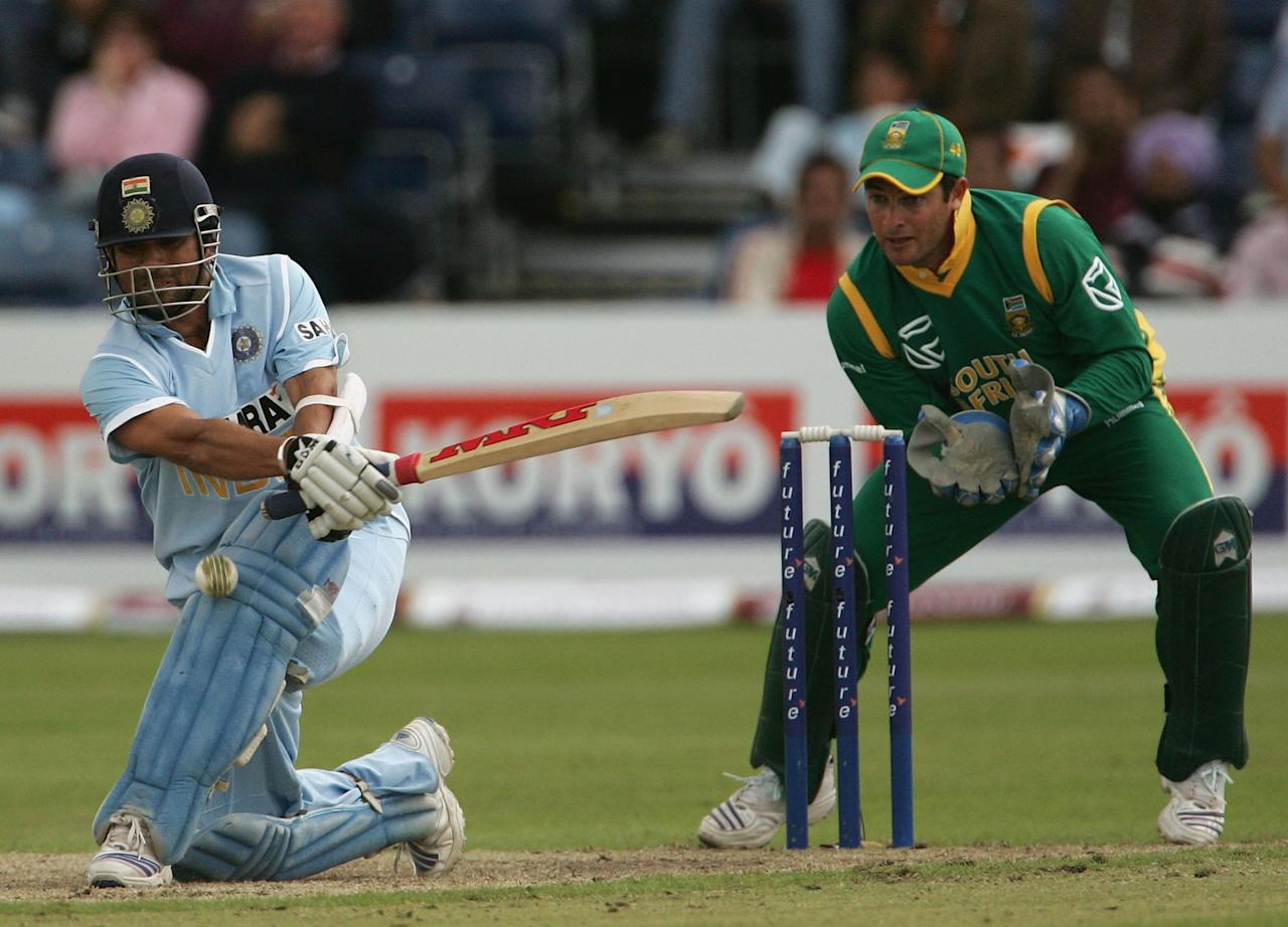 BELFAST, UNITED KINGDOM - JUNE 29:  Sachin Tendulkar of India attempts to sweep with Mark Boucher of South Africa looking on during the second One Day International match between South Africa and India at the Civil Service Cricket Club in Stormont on June 29, 2007 in Belfast, Northern Ireland.  (Photo by Hamish Blair/Getty Images)
