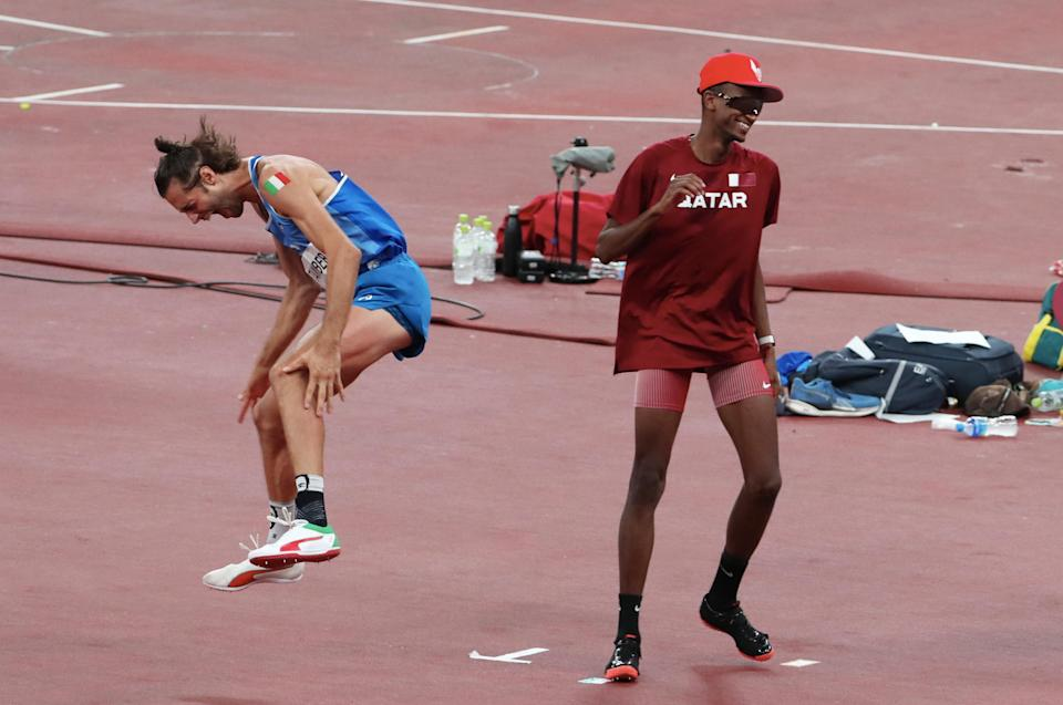 Italy's Gianmarco Tamberi (left) celebrates after Qatar's Mutaz Essa Barshim offers to share the gold medal in the men's high jump final at the 2020 Tokyo Olympics.