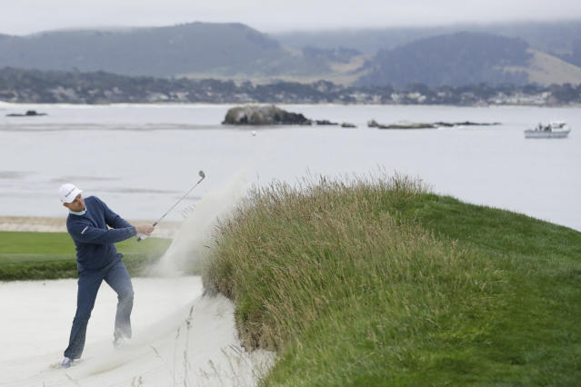 Justin Rose, of England, hits out of the bunker on the 18th hole during the third round of the U.S. Open golf tournament Saturday, June 15, 2019, in Pebble Beach, Calif. (AP Photo/Marcio Jose Sanchez)