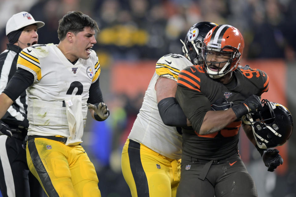 Steelers QB Mason Rudolph, left, reportedly may only receive a $35,000 fine for fighting in Thursday night's game. (AP/David Richard)