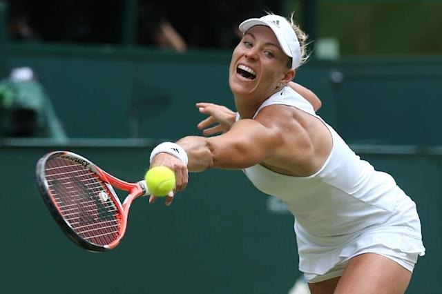 Angelique Kerber hits a return against Serena Williams during the Wimbledon women's singles final on July 9, 2016 (AFP Photo/Justin Tallis)