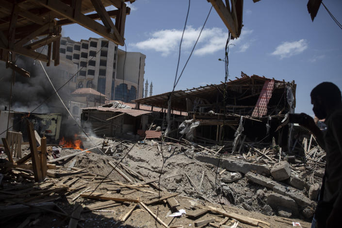 Smoke and fire rises from a beachside cafe after it was hit by an Israeli airstrike, in Gaza City, Monday, May 17, 2021. (AP Photo/Khalil Hamra)