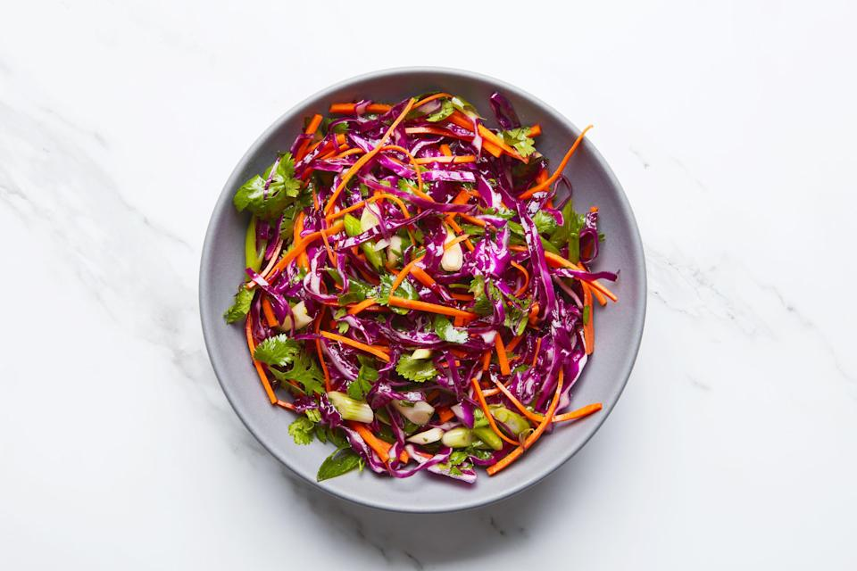 """Flavored with citrus, maple syrup, and cilantro, this slaw makes an excellent topper for tacos or <a href=""""https://www.epicurious.com/recipes/food/views/huaraches-de-nopal-decolonize-your-diet?mbid=synd_yahoo_rss"""" rel=""""nofollow noopener"""" target=""""_blank"""" data-ylk=""""slk:Huaraches de Nopal"""" class=""""link rapid-noclick-resp"""">Huaraches de Nopal</a>. <a href=""""https://www.epicurious.com/recipes/food/views/red-cabbage-slaw-with-cilantro-and-citrus-decolonize-your-diet?mbid=synd_yahoo_rss"""" rel=""""nofollow noopener"""" target=""""_blank"""" data-ylk=""""slk:See recipe."""" class=""""link rapid-noclick-resp"""">See recipe.</a>"""