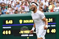Czech Republic's Jiri Vesely celebrates beating Germany's Alexander Zverev during their men's singles first round match on the first day of the 2019 Wimbledon Championships at The All England Lawn Tennis Club in Wimbledon, southwest London, on July 1, 2019. (Photo by Ben Stansall/AFP/Getty Images)