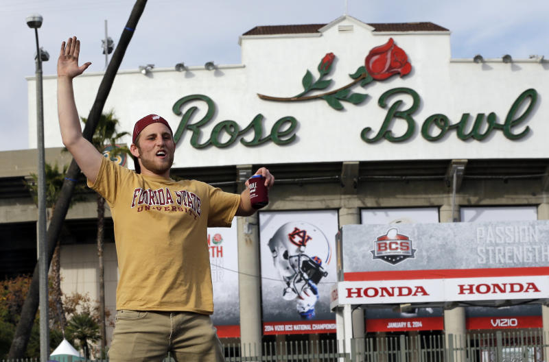 A Florida State fan cheers outside the Rose Bowl before the NCAA BCS National Championship college football game against Auburn Monday, Jan. 6, 2014, in Pasadena, Calif. (AP Photo/David J. Phillip)