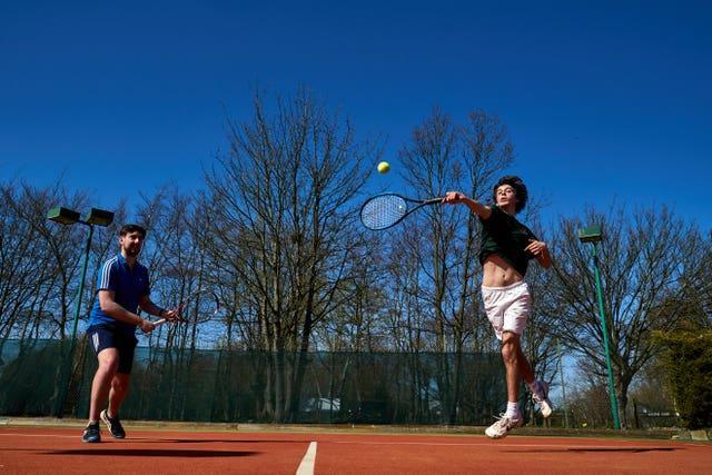 Zak Williams returns a shot at Wycombe House tennis club, Isleworth