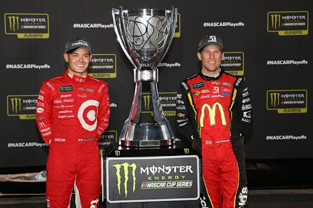 "RICHMOND, VA – SEPTEMBER 09: Kyle Larson, driver of the #42 Target Chevrolet, and <a class=""link rapid-noclick-resp"" href=""/nascar/sprint/drivers/191/"" data-ylk=""slk:Jamie McMurray"">Jamie McMurray</a>, driver of the #1 McDonald's Chevrolet, pose with the Monster Energy Series Championship trophy during the Monster Energy NASCAR Cup Series Federated Auto Parts 400 at Richmond Raceway on September 9, 2017 in Richmond, Virginia. (Photo by Sean Gardner/Getty Images)"
