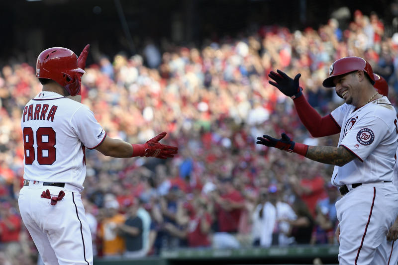 Washington Nationals' Gerardo Parra (88) celebrates his grand slam with Asdrubal Cabrera, right, during the second inning of a baseball game against the Cleveland Indians, Saturday, Sept. 28, 2019, in Washington. (AP Photo/Nick Wass)