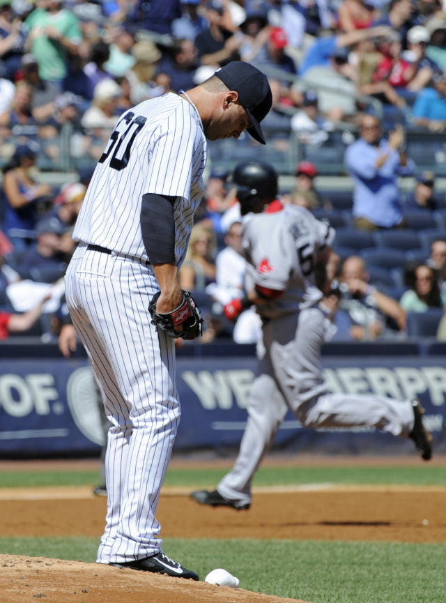 New York Yankees pitcher David Huff reacts as Boston Red Sox batter Jonny Gomes, right, rounds the bases with a three-run home run during the third inning of a baseball game Saturday, Sept. 7, 2013, at Yankee Stadium in New York. (AP Photo/Bill Kostroun)