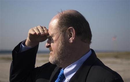 Republican New York City mayoral candidate Lhota looks towards shoreline during visit to Breezy Point, on one-year anniversary of Hurricane Sandy in New York