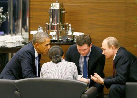 President Barack Obama (L) talks with Russian President Vladimir Putin (R) and U.S. security advisor Susan Rice (2nd L) prior to the opening session of the Group of 20 (G20) Leaders summit summit in the Mediterranean resort city of Antalya, Turkey November 15, 2015. Man at 2nd R is unidentified. REUTERS/Cem Oksuz/Pool