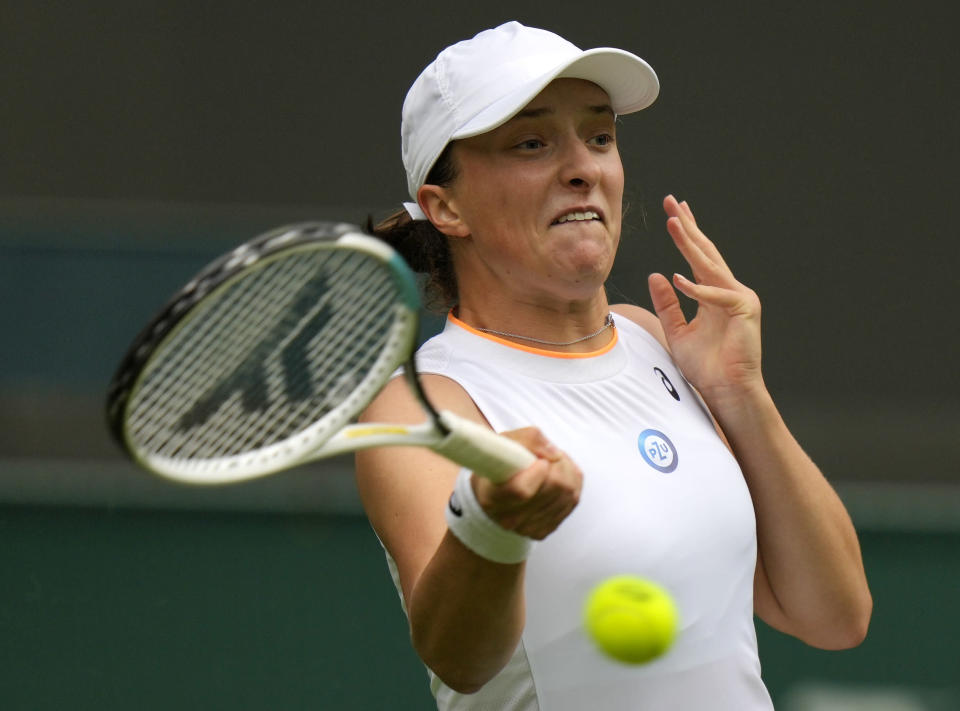Poland's Iga Swiatek returns the ball to Taiwan's Su-Wei Hsieh during the women's singles match on day one of the Wimbledon Tennis Championships in London, Monday June 28, 2021. (AP Photo/Alastair Grant)