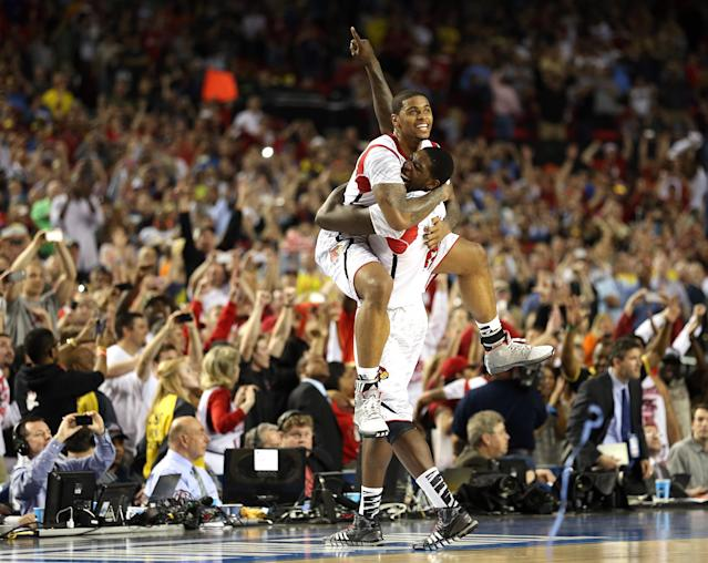 Chane Behanan (top) #21 and Montrezl Harrell #24 of the Louisville Cardinals celebrate after they won 82-76 against the Michigan Wolverines during the 2013 NCAA Men's Final Four Championship at the Georgia Dome on April 8, 2013 in Atlanta, Georgia. (Photo by Andy Lyons/Getty Images)