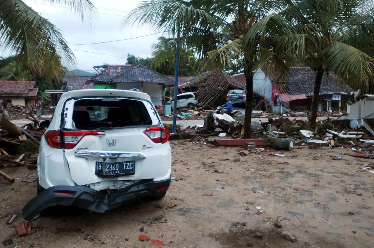 <p>Cars and debris litter a beach in Banten, on Dec. 23, 2018, after the area was hit by a tsunami on Dec. 22 following an eruption of the Anak Krakatoa volcano. A volcano-triggered tsunami has left at least 373 people dead and hundreds more injured after slamming without warning into beaches around Indonesia's Sunda Strait. (Photo by Dasril Roszandi/NurPhoto via Getty Images) </p>