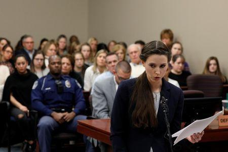 Victim Rachael Denhollander speaks at the sentencing hearing for Larry Nassar, a former team USA Gymnastics doctor who pleaded guilty in November 2017 to sexual assault charges, in Lansing, Michigan, U.S., January 24, 2018. REUTERS/Brendan McDermid